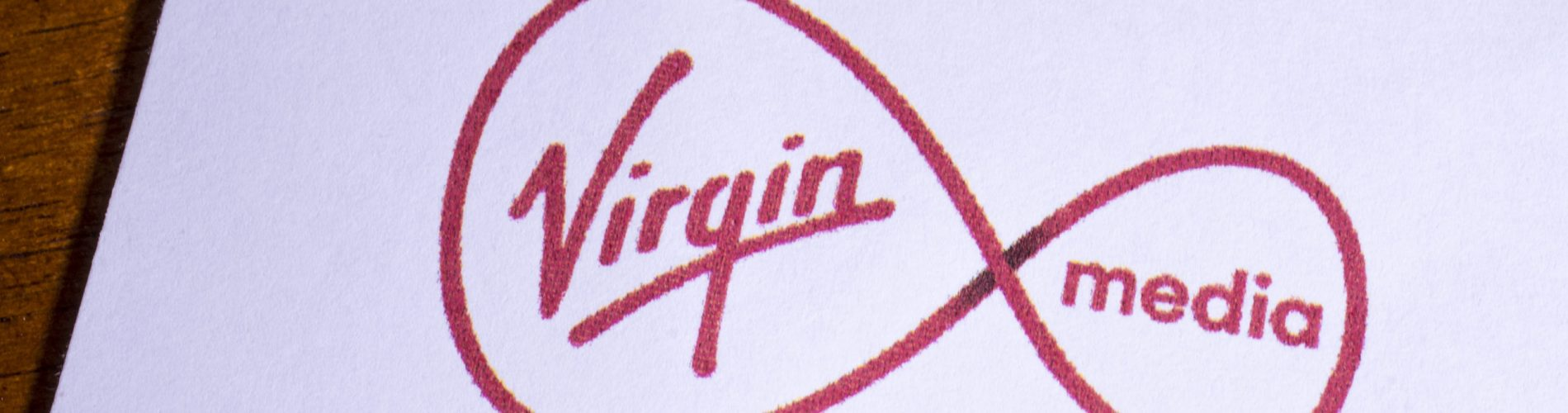 London, UK - May 14th 2019: The logo of Virgin Media Limited, pictured on the top of a letter.  Virgin Media Limited is a company providing telephone, TV and internet services in the UK.